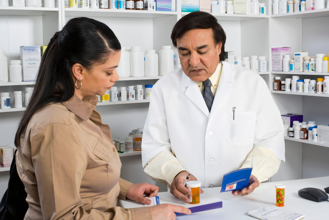 Pharmacist counselling medications to a patient